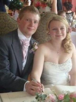 Robert Ballard and bride Alex signing their wedding certificate