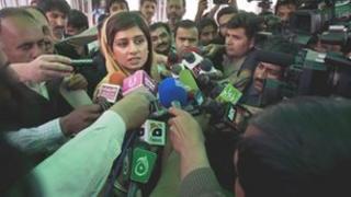 Foreign Minister Hina Rabbani Khar leaves parliament on Tuesday