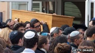 Coffin being moved from Toulouse school