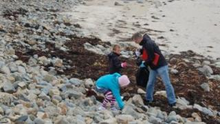 Volunteers collecting and recording litter on a Guernsey beach