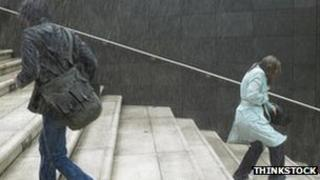 Two pedestrians caught in the rain