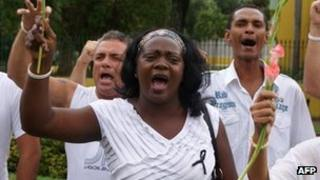 Picture of Berta Soler standing still protesting