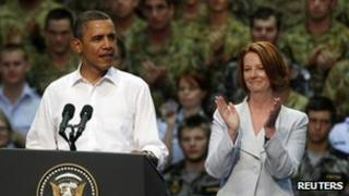 US President Barack Obama speaking to US Marines and Australian troops at the RAAF Base as Australian Prime Minister Julia Gillard listens, in Darwin, on 17 November, 2011
