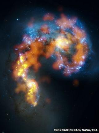 The Antennae (B. Saxton, (NRAO/AUI/NSF), ALMA (ESO/NAOJ/NRAO). Visible light image: the NASA/ESA Hubble Space Telescope)