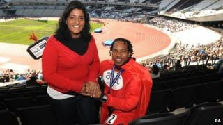 Wendell Raphael (right) proposes marriage to his girlfriend Bindi Bhambra during the Gold Challenge event at the Olympic Stadium