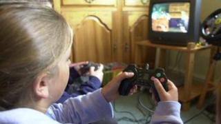 Girl playing on Play Station