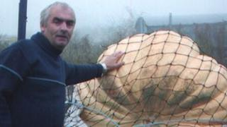 Clive Bevan with a giant pumpkin