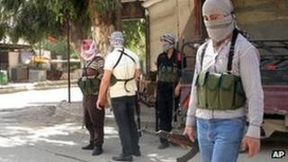 Free Syrian Army rebels gather in a Damascus suburb, 6 April