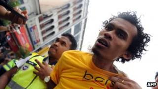 File photo (July 2011) of police arresting Malaysian protester