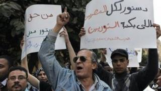 "Egyptian protesters chant carry banners saying: ""A constitution for all Egyptians must be written by the rebels, civilian constitution is our basic right."" (28 March 2012)"