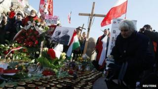 People take part in an event outside the Presidential Palace in Warsaw April 10, 2012.