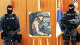 Serbian policemen guard Cezanne's The Boy in the Red Vest