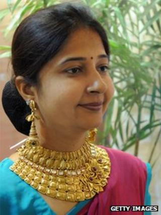 A woman models a 22 carat gold necklace in Ahmedabad