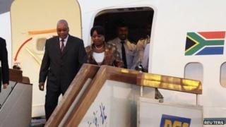 South Africa's President Jacob Zuma and his partner Gloria Bongi Ngema arrive at Beijing international airport (August 23, 2010 file)
