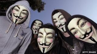 Protesters wearing 'Anonymous' masks