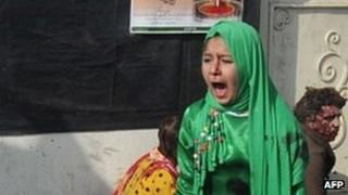 Tarana Akbari crying after a suicide bomber's attack at a shrine in Kabul