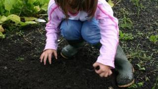 Girl with earthworm