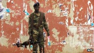 A soldier stands guard in a street near the National Assembly in Bissau, the capital of Guinea-Bissau, on 13 April 2012