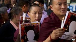 Exile Tibetans in India participate in a candle lit vigil to mark the two latest self-immolations in Tibet. Thursday, April 19, 2012
