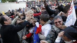 Francois Hollande meets voters in Cenon, south-west France, 19 Apr 12
