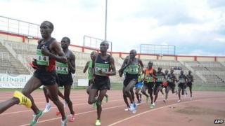 Kenyan athletes run the men's 10,000m on 17 April 2012 at the Nyayo national stadium in Nairobi during the pre-trials ahead of 2012 London Olympics