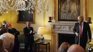 David Cameron laughs as London Mayor Boris Johnson delivers a speech at a reception for UK mayors