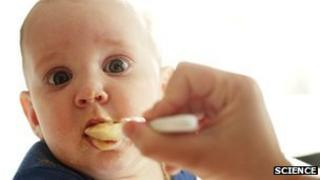 Baby being fed