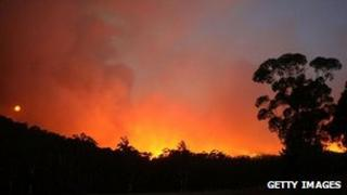 Picture of the Australian bush with the sky lit up by fire