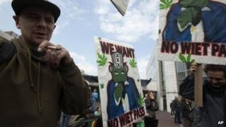 Protesters in the Netherlands with signs opposing the new weed pass