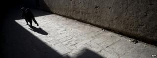 Boy playing in Kabul street