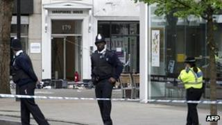 Police outside an office building in Tottenham Court Road