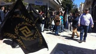 Members of the Golden Dawn party campaigning