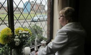 Maureen Walsh looks out of her window
