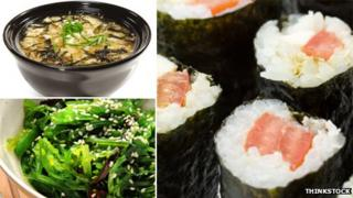 Sushi rolls, miso soup and seaweed salad