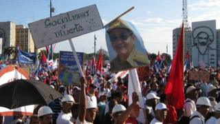 A sign reading 'Socialism or Death' at Havana's May Day march