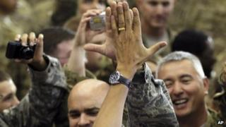 President Obama high-fives military personnel at Bagram air field on 2 May 2012