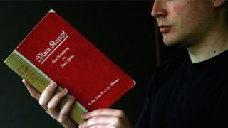 Man reading Mein Kampf