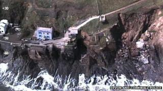 An aerial photograph taken by a police helicopter after a 200-tonne section of the cliff fell into the sea on 6 May