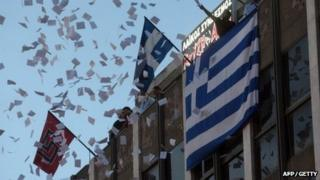 Members of Neo-Nazi party Golden Dawn celebrate after the elections