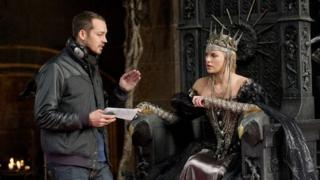 Director Rupert Sanders with Charlize Theron as the wicked Queen Ravenna