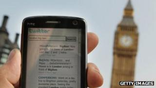 A smartphone displaying a Twitter feed with Big Ben in the background