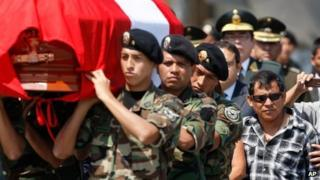 Dionisio Vilca walks behind his son's coffin at the police airport in Callao 3 May 2012