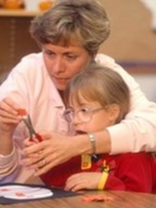 A girl with learning difficulties and her teacher (Science Photo Library)