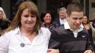 Sam Hallam, 24 leaves the Court of Appeal in London, with his mother Wendy, after he was freed on bail