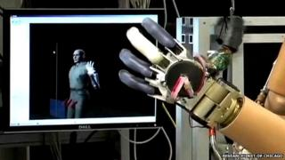 robotic hand in front of screen
