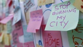 "Post-It messages about last summer's riots such as ""Stop burning my city"""
