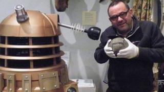 Huw Williams holds football as Dalek looks on