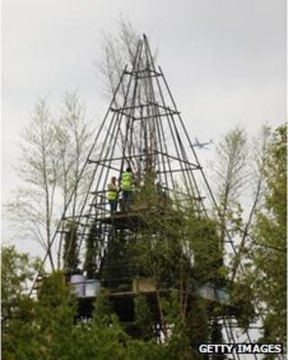 Workers prepare the pyramid design at Chelsea Flower Show