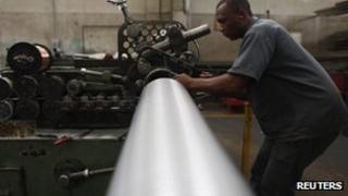 An employee works at the Sociedade Paulista de Tubos Flexiveis (SPTF) metallurgical company