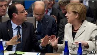 Francois Hollande and Angela Merkel at the Nato summit in Chicago, 21 May 2012